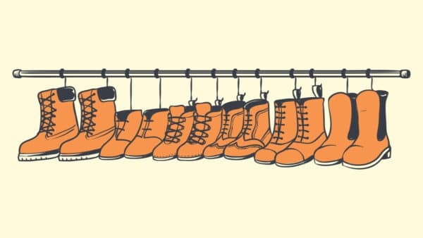Types of Boots Cartoon of a row of boots hanging on boot hangers plain background