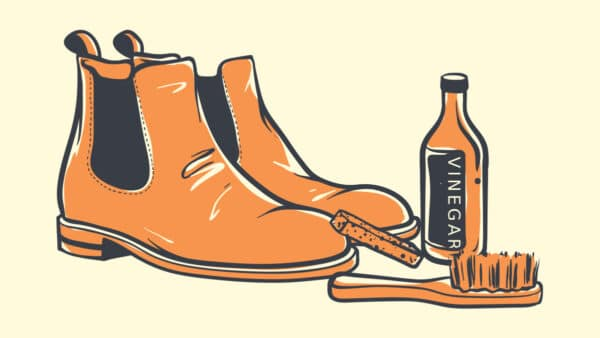How to Clean Suede Boots Cartoon of Chelsea Boots next to a Suede Brush and Vinegar Bottle