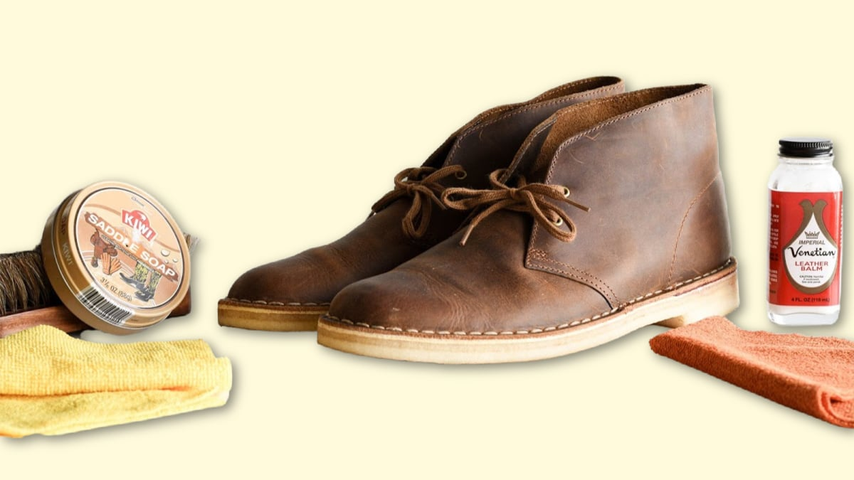 How to Clean Clarks Desert Boots Clarks Desert Boots surrounded by cleaning products