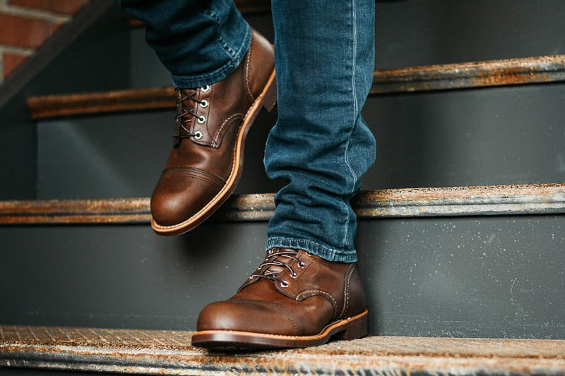 Red Wing Iron Ranger on model walking down rusted steps