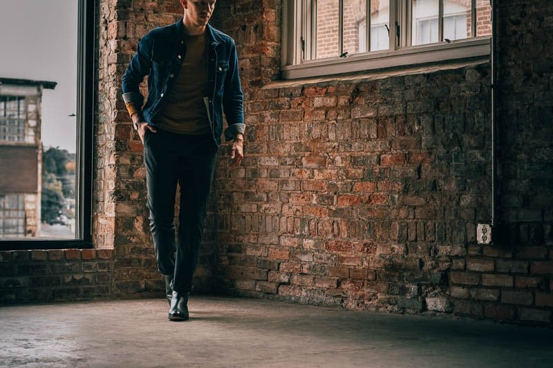 model against brick wall wearing black beckett simonon boots