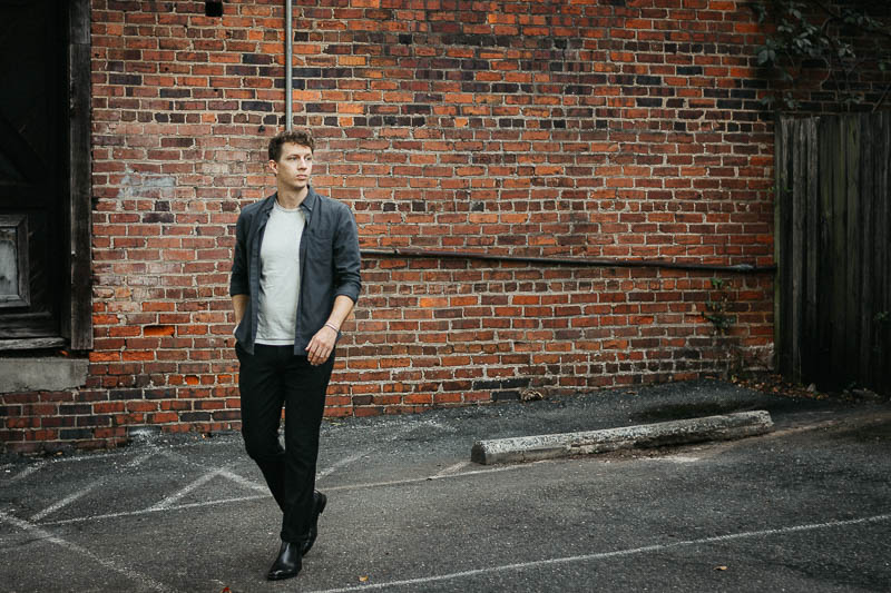 model wearing ace marks chelsea boots and black chinos