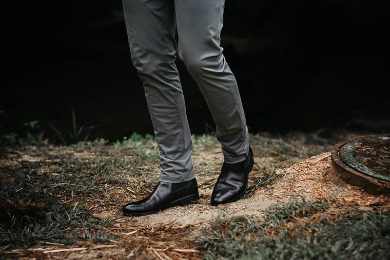 model wearing black ace marks chelsea boots