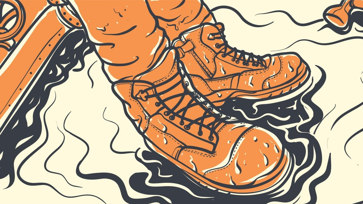Best Waterproof Work Boots for Men Cartoon of man wearing work boots standing in puddle