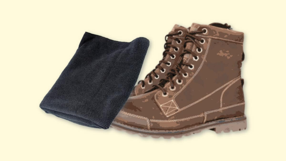 How to Clean Timberlands  Image of Microfiber towel cleaning a pair of Timberland EarthkeepersPlain Background