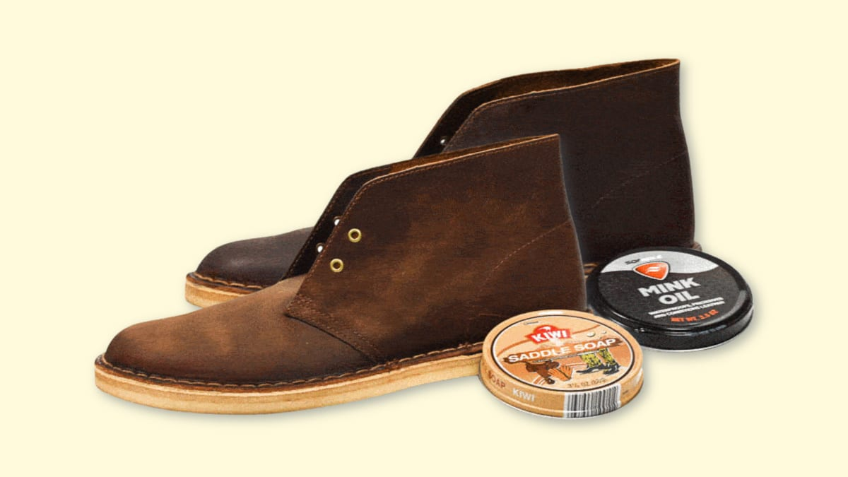 How to Darken Leather Boots  Image of Clarks Desert Boots side by side with Mink Oil and Saddle Soap