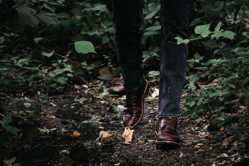 Thursday Captain boots model walking in the woods