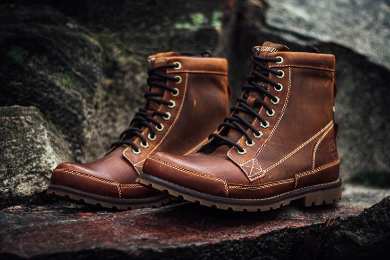 Timberland Earthkeepers side-on sitting on rock close