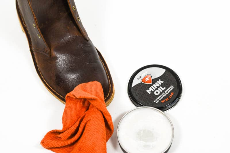 applying sofsole minkoil to leather boot