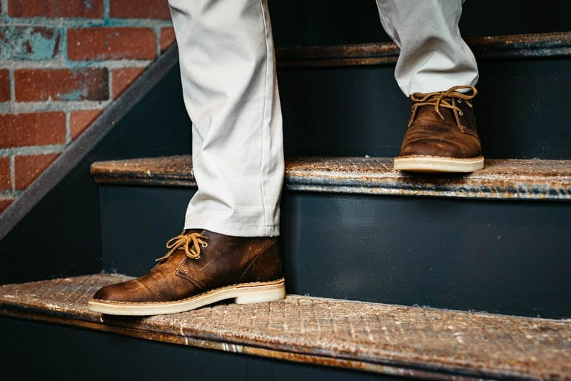 close up of clarks desert boot and khaki pant