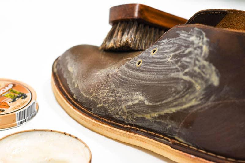 sudsing up kiwi saddle soap on leather boots