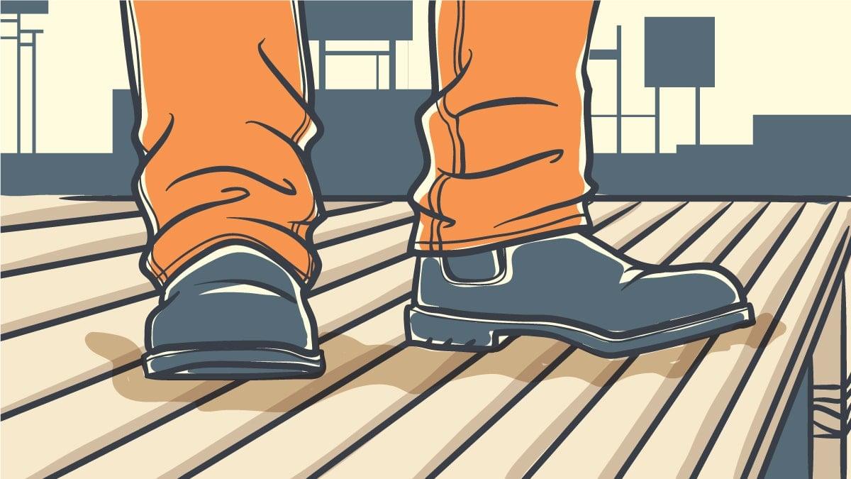 Best Work Boots Under 100 Cartoon of Man at Worksite Wearing Work Boots