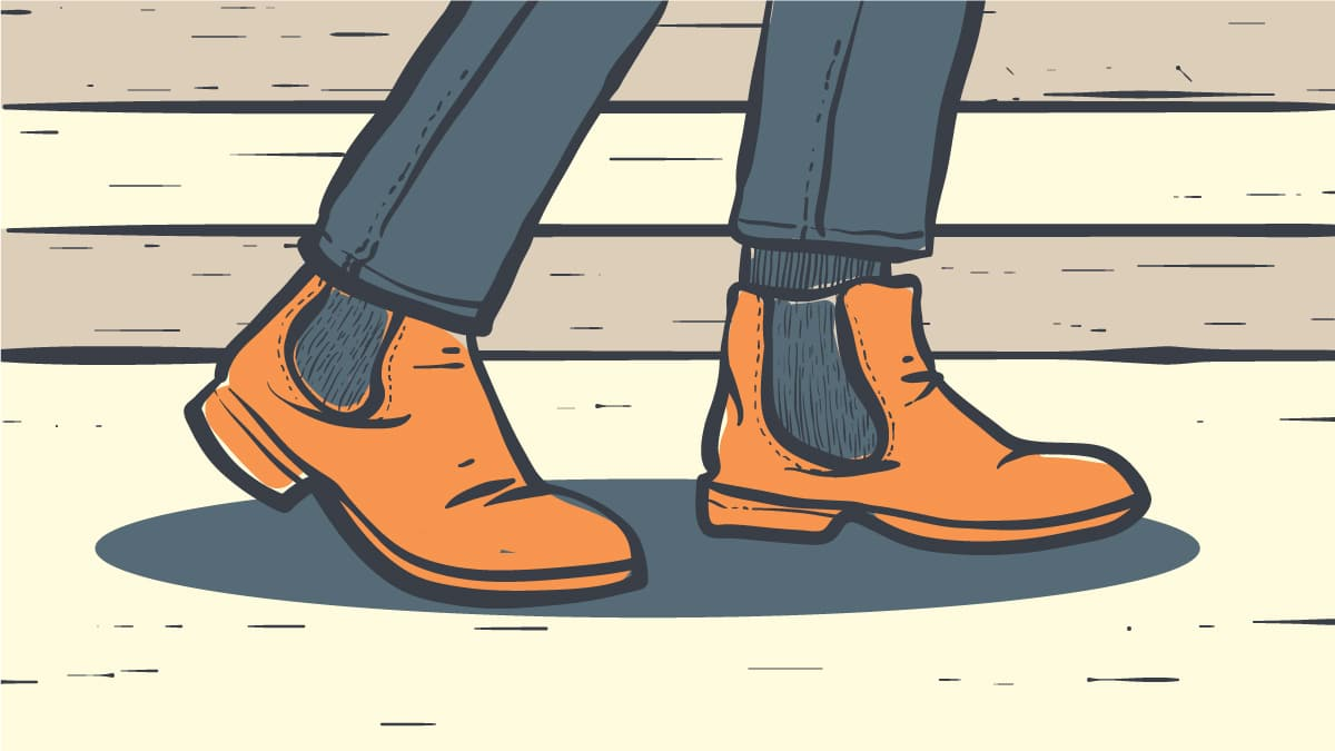 Best Boots for Flat Feet Cartoon of Man wearing Chelsea boots and walking