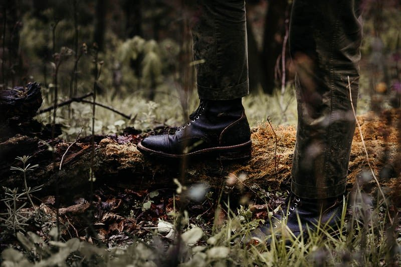Thursday Boots Logger on logs in woods with moss
