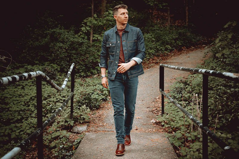 model wearing Nisolo chelsea boot with jeans and denim shirt