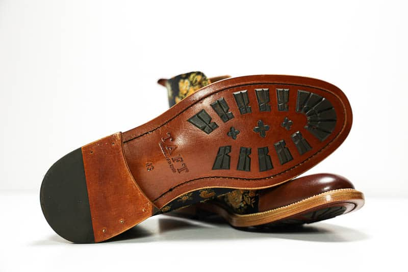 Taft Jack leather and rubber stud sole detail