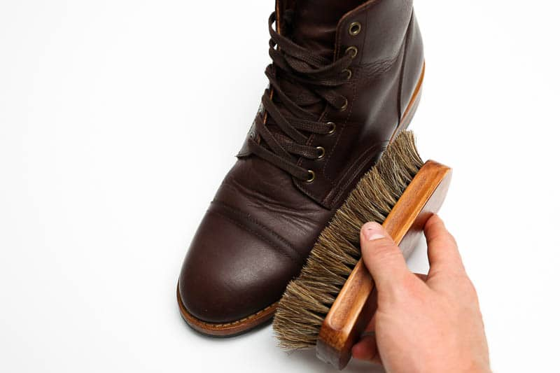 brushing boot with a horsehair brush