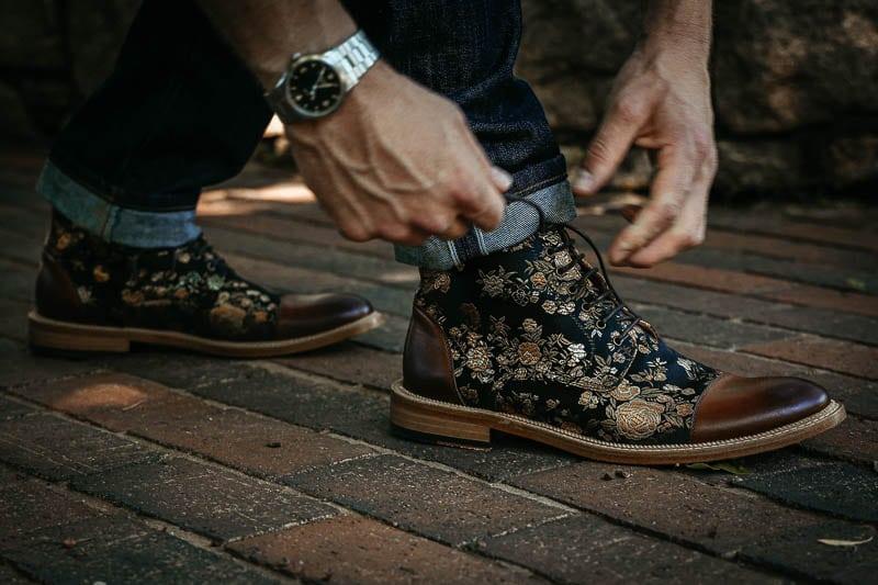 model tying Taft Jack boot