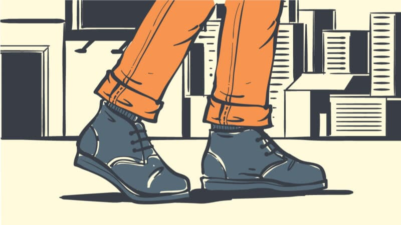 How to wear chukka boots cartoon drawing of man wearing chukka boots with cityscape background