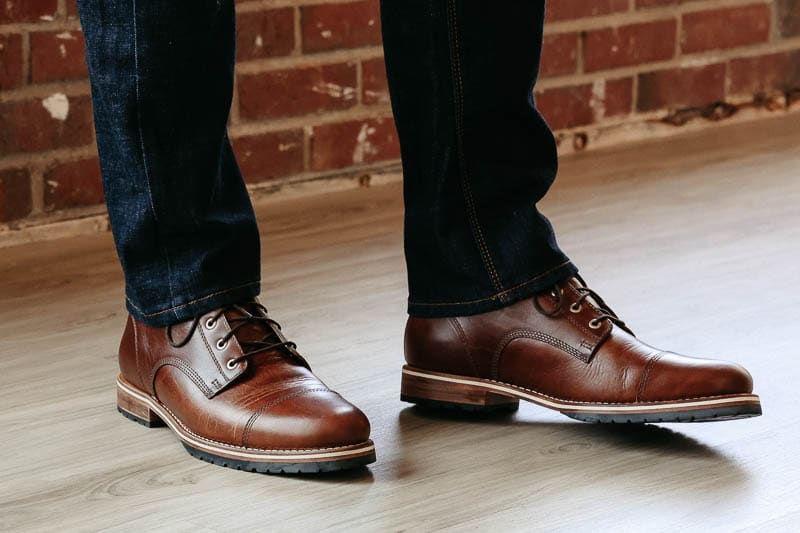 Helm Boots on feet midsole view