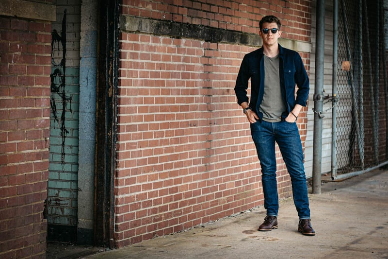 Model Wearing Oliver Cabell SB1 Boot with Jeans Against Brick Wall