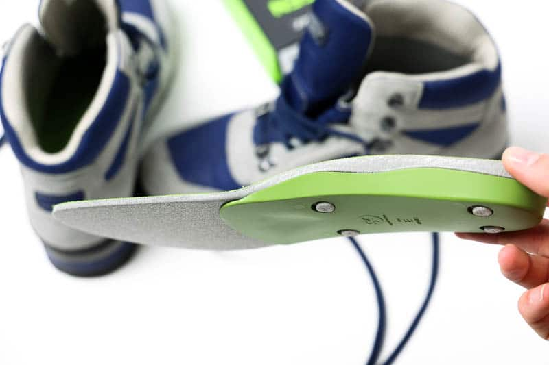 superfeet green insole being placed in hiking boot