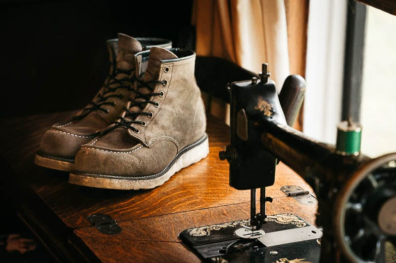 Red Wing Moc Toe next to sewing machine