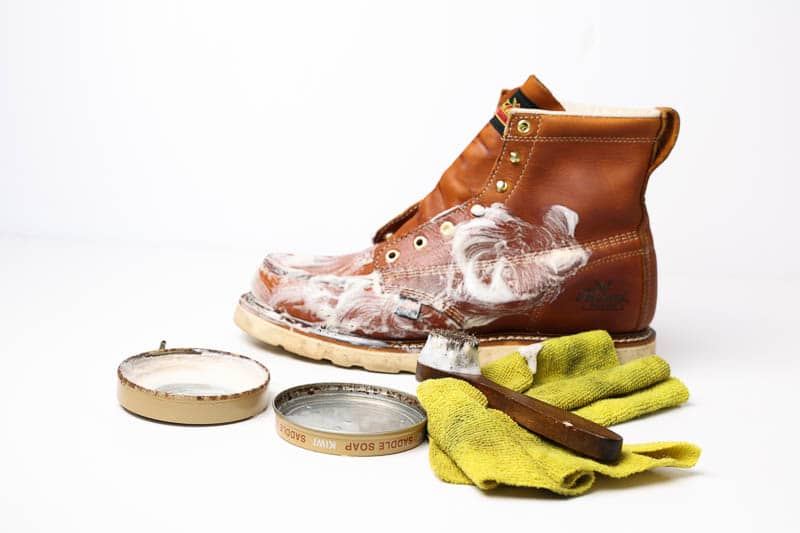 cleaning leather boot with saddle soap