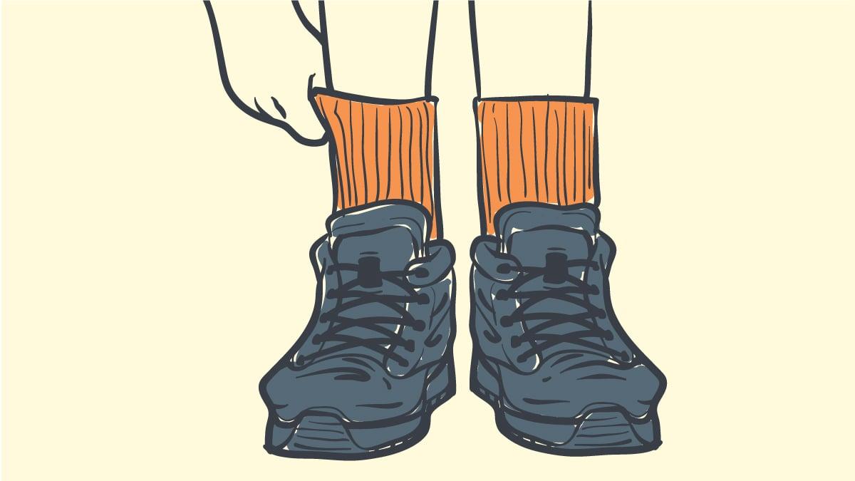 Best socks for sweaty feet in work boots cartoon image of man pulling up socks in work boots