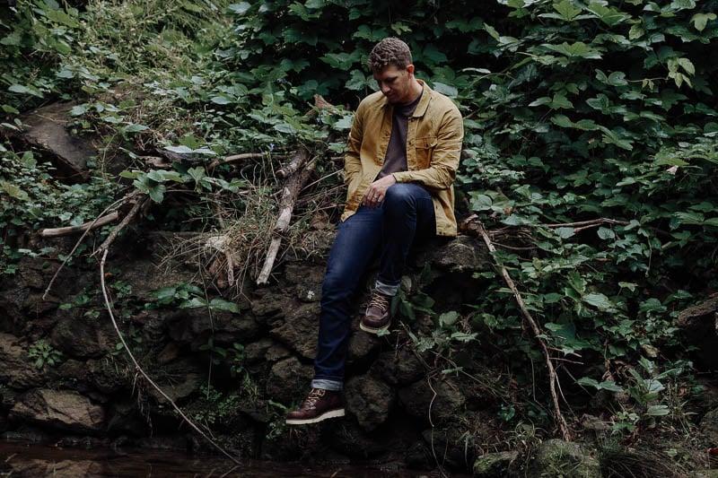 Danner Bull Run boots on model sitting on wall