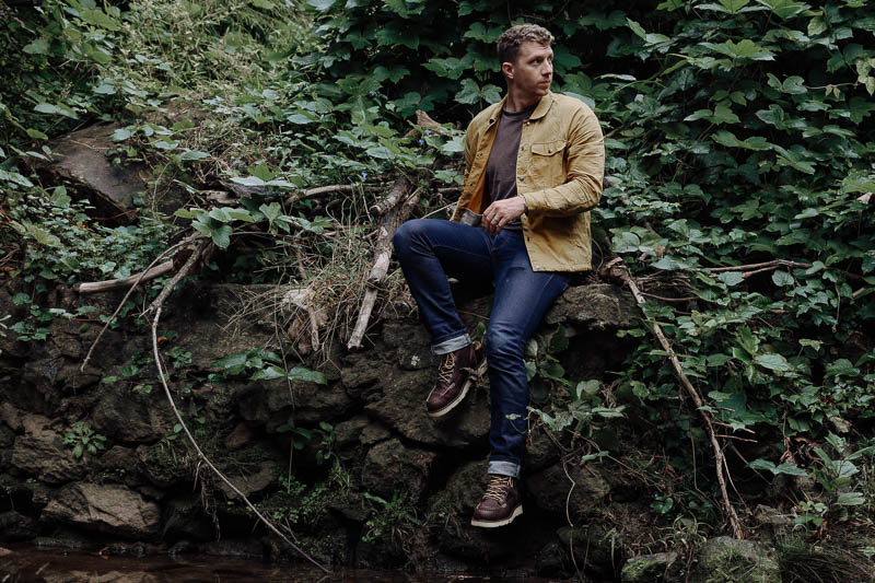 model wearing yellow jacket and Danner Bull Run boots